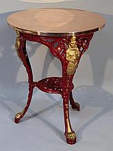 A principally 19th Century pub table, the circular brass top raised on an elaborate stand set with f