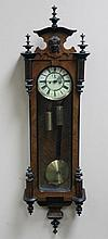 A 19th Century walnut Vienna wall clock, the part ebonised case with glazed door and sides revealing