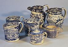 An early 19th Century blue and white jug, of bulbous ribbed form set with a coat of arms and various