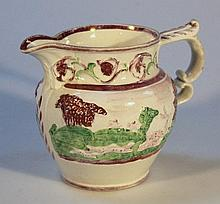 A 19th Century Thomas Fell pink lustre jug, of bulbous form, with moulded beak spout and double scro