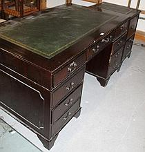 A mahogany finish twin pedestal writing desk, the one piece part stencilled leatherette top raised a