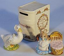 A Royal Doulton Bunnykins money box, celebrating Prince Harry's birth, of book form transfer printed