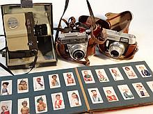 Various cameras, to include Voighander with 2.8/50 lens, Kodak Retina IIF, 11cm high, various cigare