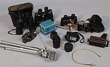 A quantity of cameras and binoculars, to include Pentacon camera with lens, 10x50 field binoculars,