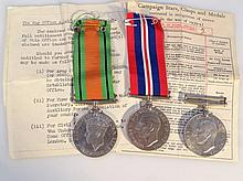 WWII medals, comprising a Campaign medal and two Defence medals, two ribbons, contained in a box add