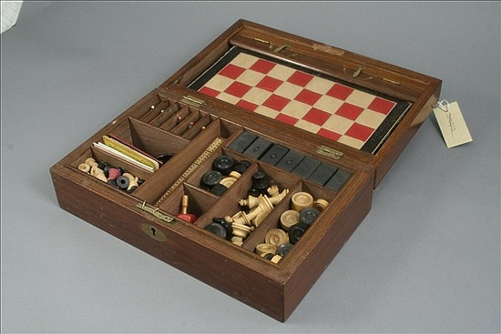 An early 20th century mahogany games compendium, 13.5ins