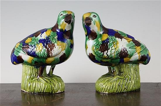 A pair of Chinese glazed biscuit porcelain figures of standing quail, 5.5in.