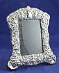 A 1990's Edwardian style repousse silver photograph frame, 8in.
