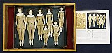 An early 20th century Hertwig & Co sample box of seven graduated Naking Puppen dolls,