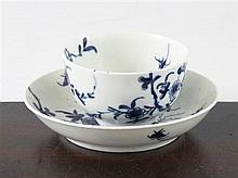 A Worcester Prunus Root pattern teabowl and saucer, c.1760, saucer 11.7cm.