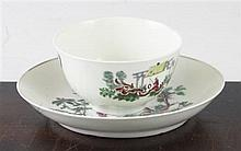 An early Worcester 'Les Garcon Chinois' tea bowl and saucer, c.1760, saucer 11.9cm.
