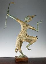 A Burmese gilt and green patinated bronze model of an archer, 29.75in.