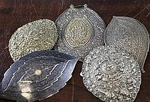 Five Chinese and Malaysian silver belt buckles, late 19th / early 20th century, 14.5cm. - 19.5cm.