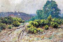 Wynford Dewhurst (1864-1941) French landscape with track leading to a town, 12 x 19in.
