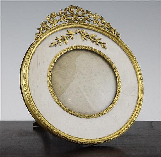 A late 19th century French circular photograph frame, 7.75in.