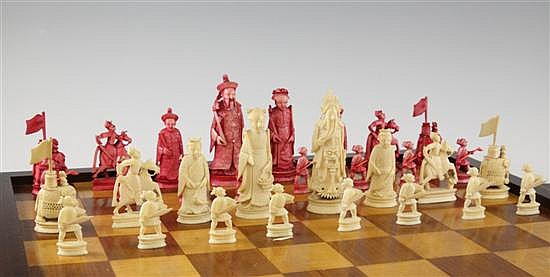 A Chinese carved and red stained ivory chess set