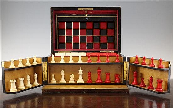 A late 19th century Jaques of London amboyna games compendium, kings 2.5in.; box 12.75in.