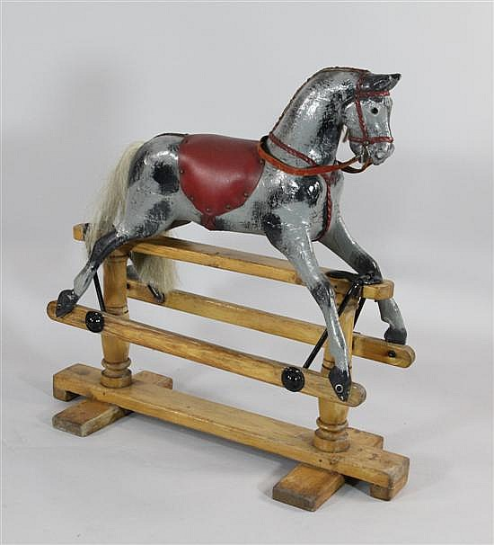 A small pine rocking horse, by Lines Bros, 34 x 36in.