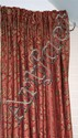 A pair of pink silk floral brocade curtains with matching swag and tail pelmet