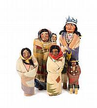 Five Souvenir Skookum Dolls, Height of tallest: 14 inches.