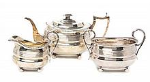 A George III Silver Assembled Three Piece Tea Set,, , ovoid bodies with horizontal reeded bands, comprising a teapot and creamer, Edinb
