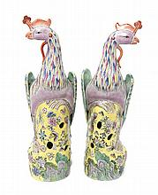 A Pair of Chinese Export Porcelain Models of Phoenixes, Height 19 inches.
