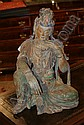 A Chinese Carved Wood and Polychrome Painted Figure of a Seated Guanyin, Height 19 1/2 inches.