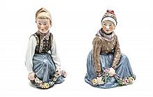 A Pair of Royal Copenhagen Porcelain Figures, Height 6 inches.
