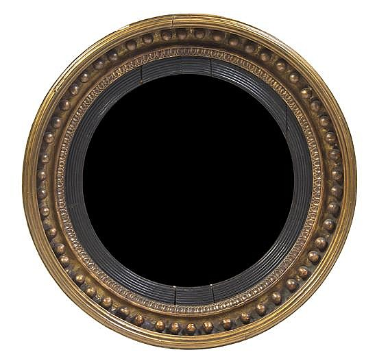 * An Ebonized and Parcel Gilt Bullseye Mirror, Diameter 26 1/4 inches.