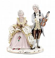 A Dresden Porcelain Figural Group, Height 7 1/2 inches.