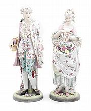 Two German Porcelain Figures, Height of each 22 inches.
