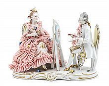 A German Porcelain Figural Group, Height 7 1/4 x width 9 1/4 x depth 4 1/4 inches.