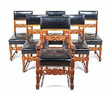A Set of Six American Carved Oak Chairs Height of tallest 41 inches.