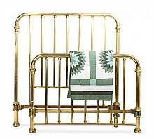 A Victorian Brass Bed and Quilt Height 59 x width 54 x depth 76 inches.