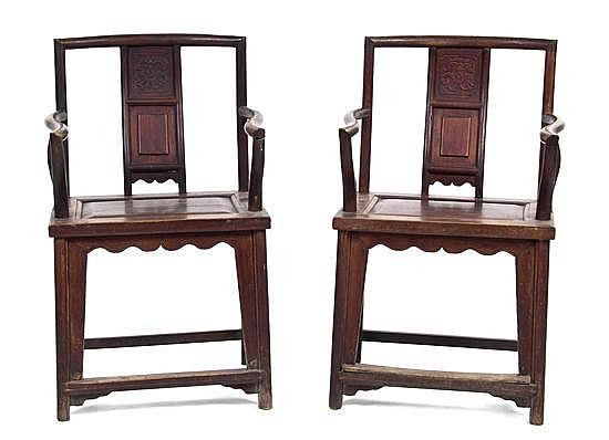 A Pair of Chinese Carved Elm Armchairs, Height 37 1/2 inches.