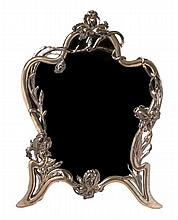 * An Austro-Hungarian Art Nouveau Silver Dressing Mirror, Height 24 1/2 x width 18 1/4 inches.