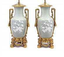 A Pair of Louis XVI Style Gilt Bronze Mounted Pate-sur-Pate Urns Height overall 31 1/2 inches.
