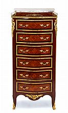 A Louis XV/XVI Transitional Style Gilt Metal Mounted Mahogany Tall Chest Height 49 x width 24 1/2 x depth 14 1/4 inches.