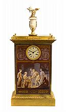 * An Empire Gilt Bronze and Porcelain Mantel Clock 19TH CENTURY Height overall 28 1/4 inches.