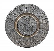 A Continental Repousse Metal Roundel Diameter 18 1/4 inches.