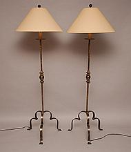 Pair of metal floor lamps with tripod bases, 68