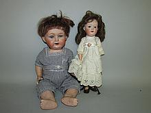 2 Japanese bisque head dolls
