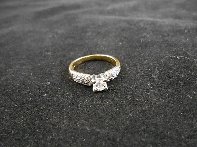 A .750 gold ring set with solitaire diamond with