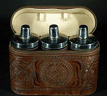 3 Antique Wine Bottles in Leather Case