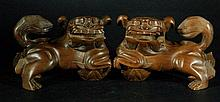 Pair of Highly Carved Huangyang Wood Fu Dogs
