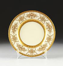 A SET OF TWELVE MINTONS PARCEL-GILT ON IVORY GROUND SERVICE PLATES, PATTERN H4164, IMPRESSED AND OVERGLAZE MARKS, RETAILED BY TIFFANY & CO., ENGLISH, CIRCA 1928,