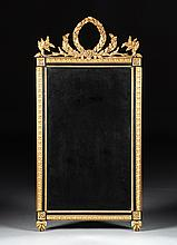 A LOUIS XVI STYLE PARCEL GILT CARVED WOOD MIRROR, 20TH CENTURY,