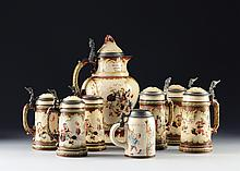 A VILEROY & BOCH POLYCHROME DECORATED STONEWARE EWER AND SEVEN STEINS, METTLACH, GERMANY, IMPRESSED AND PRINTED ABBEY MARKS WITH NUMBERS, LATE 19TH/EARLY 20TH CENTURIES,