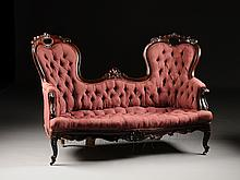 AN AMERICAN ROCOCO REVIVAL ROSEWOOD DOUBLE BACK DAMASK UPHOLSTERED AND TUFTED SETTEE, CIRCA 1840,