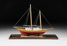 A VINTAGE AMERICAN STAINED AND PAINTED WOOD SHIP MODEL OF THE PINKY SCHOONER,